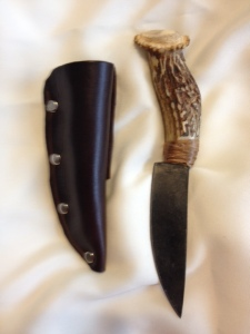 8271506 Forged Carbon Steel Blade w/ Antler Handle Blade is made from forged blade, carbon steel. Handle is antler from whitetail deer. Handmade Leather sheath. Overall Length: 8 1/2